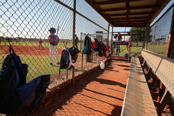 In this May 2020 photo, the teams do not sit in the dugout during their at bat side of the innings at the A.C. Caplinger Sports Complex in Hafer Park in Edmond. This year, with youth sports returning to close to pre-pandemic levels, should there be cause for concern?