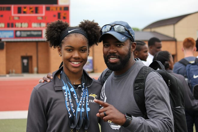 Southmoore track star Jada Atkinson, left, poses with her dad and coach, Shannon.