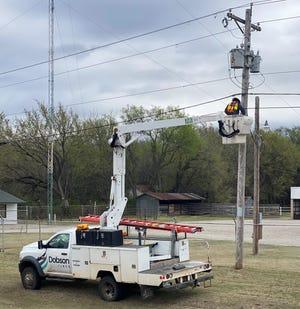 A Dobson Fiber worker installs network fiber optic cable.