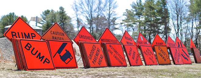 A stockpile of highway construction signs on Route 3 in Marshfield.