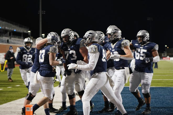 Members of the UNH football team celebrate a touchdown during it season-opening spring game against Albany. It would be the only game the Wildcats would play.