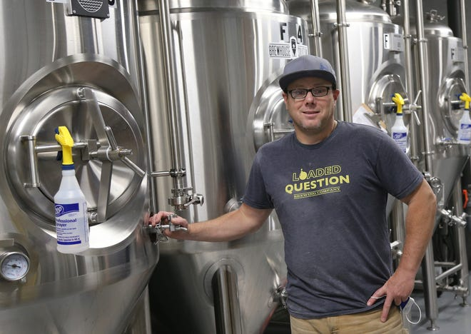 Tom Bath, co-owner and brewmeister at the Loaded Question Brewing Co. in Portsmouth, has felt the positive effect of the reduction in the federal beer excise tax on his business.