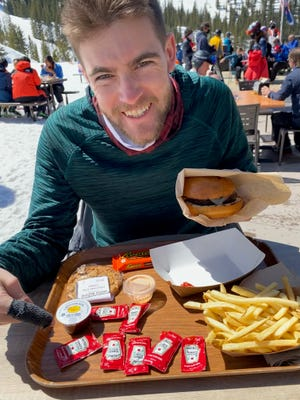 Mark Patinkin's son Zach with a typical Patinkin Heinz supply for a burger and fries — but disaster now looms, with ketchup packets in short supply.