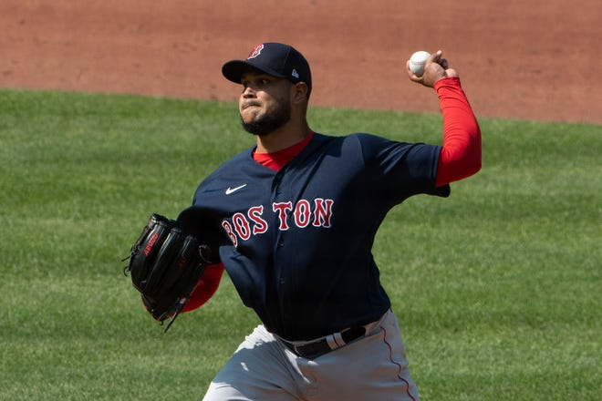 Red Sox pitcher Eduardo Rodriguez (57) delivers a pitch during the first inning against the Baltimore Orioles at Oriole Park at Camden Yards on Thursday afternoon. It was his first regular season start since 2019.