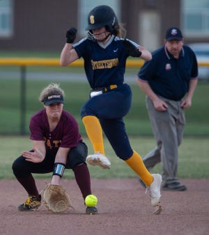 Streetsboro hosted Southeast for a non-conference softball game with the Pirates winning 10-3. Raelyn States jumps over a ground ball as McKenna Miller scoops it up.