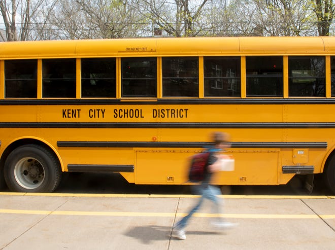A school bus sits in front of Davey Elementary School in Kent.