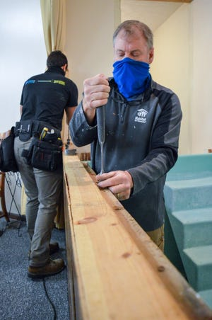Volunteers from Habitat for Humanity East Central Ohio install a new baptistry at the Southeast Church of Christ in Canton as part of a larger neighborhood renewal project.