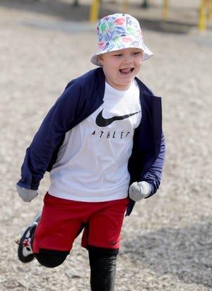 Lohr Elementary School kindergartner Deagon Campbell enjoys recess with his classmates on an unseasonably warm day in early April.