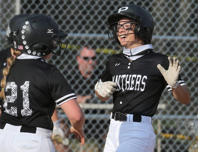 Amber Miller of Perry is welcomed home after her home run scored three during their game against GlenOak at Perry on Wednesday, April 7, 2021. Ryanne McCollister (21) was one of the players who scored on the play.