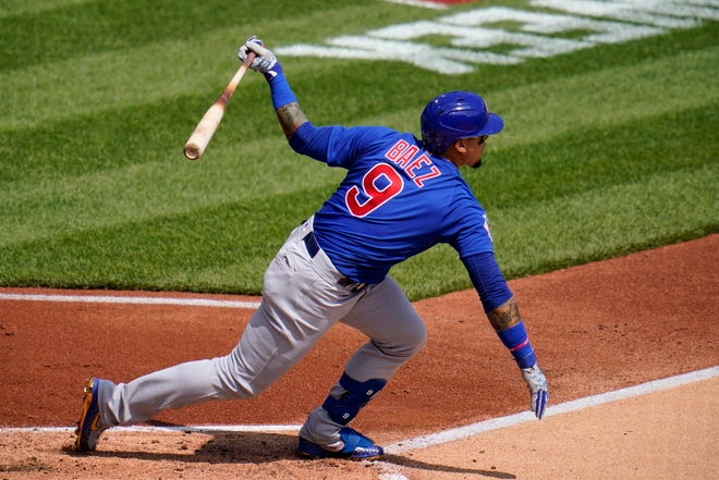 Chicago Cubs' Javier Baez singles off Pittsburgh Pirates starting pitcher Tyler Anderson during the first inning of a baseball game in Pittsburgh, Thursday, April 8, 2021. Baez had a two-run home run in the sixth inning to help the Cubs to a 4-2 win over the Pirates.