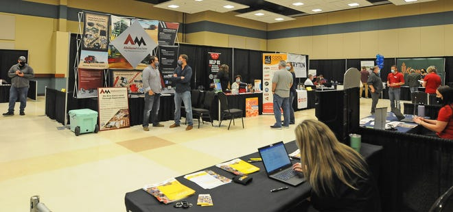 Area businesses look for qualified candidates during the Salina Area Job Fair in the Great Plains Manufacturing Convention Hall at the Tony's Pizza Events Center on Wednesday evening. The job fair was hosted by the Salina Area Chamber of Commerce and was the first one held in over a year due to the pandemic, the event had 36 businesses looking to hire.