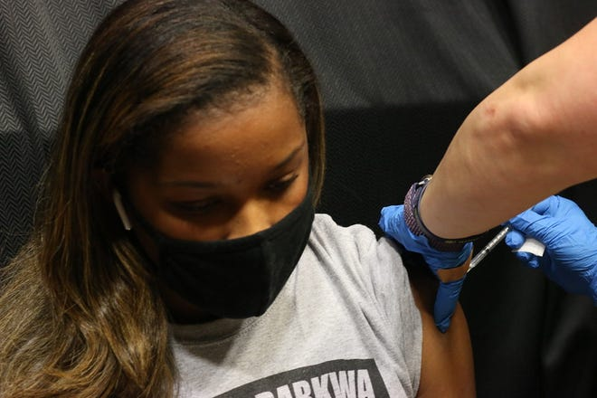 A student is given her first dose of the coronavirus vaccine on Wednesday at Gardner-Webb University.
