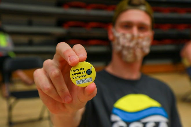 Buttons celebrating people's first shot of the coronavirus vaccine were handed out on Wednesday.