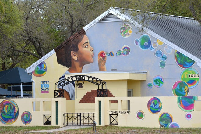 """""""Bubbles"""" was painted by Truman Adams for the First 1000 Days Sarasota project on the side of the 40 Carrots Family Center building at 1500 S. Tuttle Ave., Sarasota."""