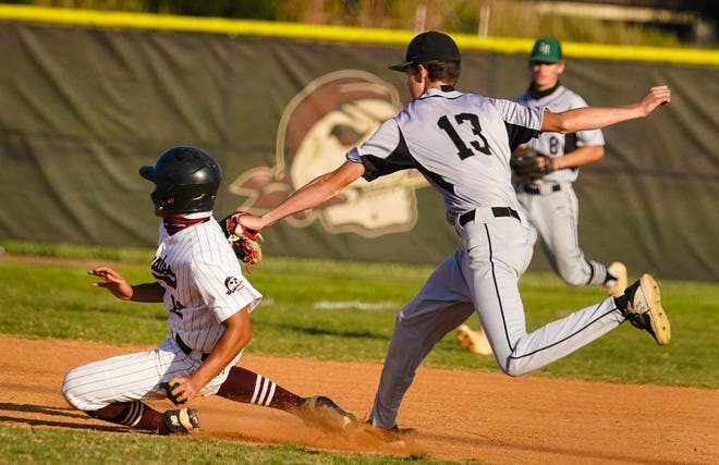 Braden River's Sean Vitug is chased by Lakewood Ranch's Ryan Combs after being caught between second and third during Wednesday's game. Vitug was tagged out.