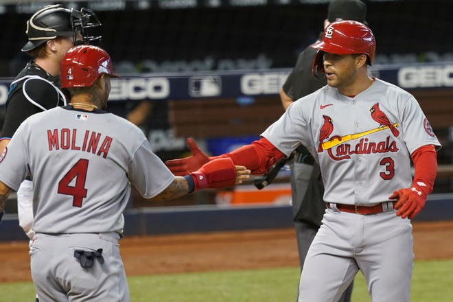St. Louis Cardinals Yadier Molina (4) congratulates Dylan Carlson (3) after Carlson hit a grand slam in the ninth inning against the Miami Marlins, Wednesday, April 7, 2021, in Miami.