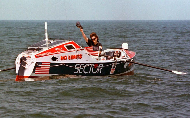 Rower Tori Murden, of Louisville, Kentucky, waves from her boat off North Carolina's Outer Banks, near Nags Head, North Carolina, on June 14, 1998. A musical about Murden, who was the first American to row across the Atlantic Ocean solo in 1999, was supposed to make its stage debut at the Williamstown Theatre Festival in Massachusetts in the summer of 2020. But due to the global pandemic, it is instead made its world premiere April 8 as a recording available on Audible.