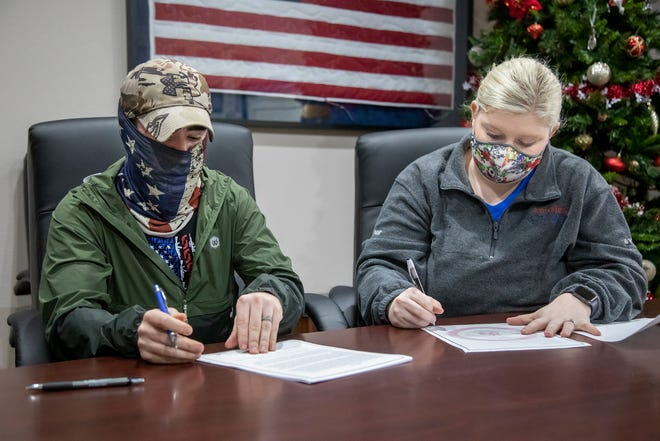 Seth and Ashley Garcia sign a lease agreement for their new home at CPN Housing Authority, Monday, Jan. 11, 2021.