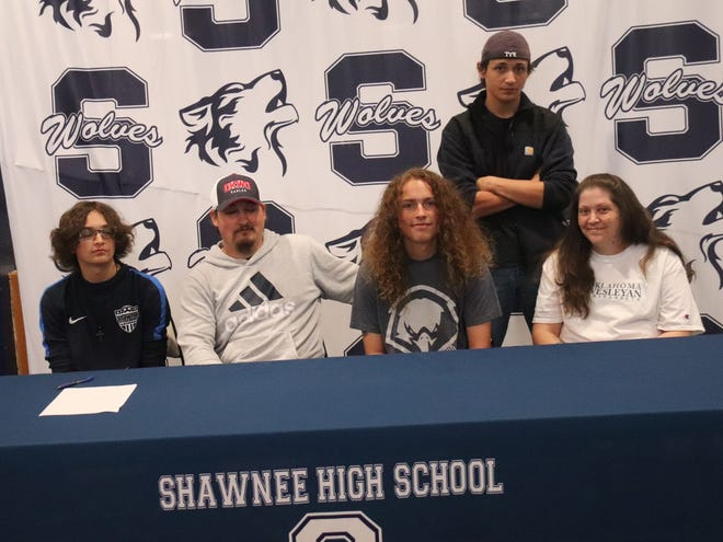 Shawnee High School senior goalkeeper George Coons (second second from right) signs a letter of intent to play soccer at Oklahoma Wesleyan University in Bartlesville next season. Seated with George from left are brother Zach, father Josh and mother Ginny. Standing is brother Josh Jr.