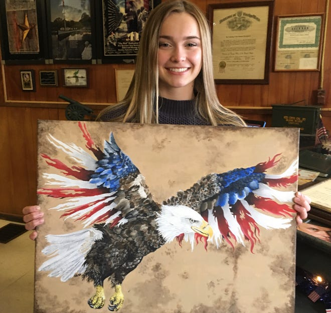 Chloe Gruszeczka shows off her first-place entry in the VFW Auxiliary Post 8078 Young American Creative Patriotic Art Contest.