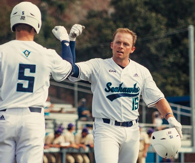 Matt Suggs is congratulated at home plate during UNCW's series against Western Carolina in 2021. He leads the team in home runs and is second in RBI heading into a weekend series at Oklahoma State.