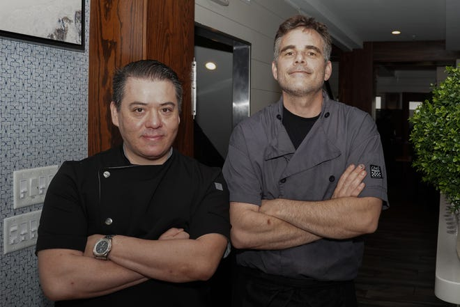 Katsuji Tanabe (left), culinary director for LM Restaurants and Tim Lyons, executive chef for Oceanic in Wrightsville Beach, at The Azalea Festival Chefs' Series dinner in April. [STARNEWS FILE PHOTO]