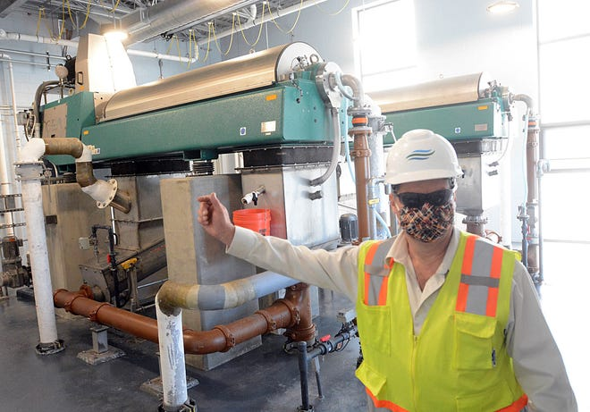 David Capacchione, Killingly town engineer, at a new centrifuges that separates liquids from solids at Killingly Water Pollution Control Facility Thursday.