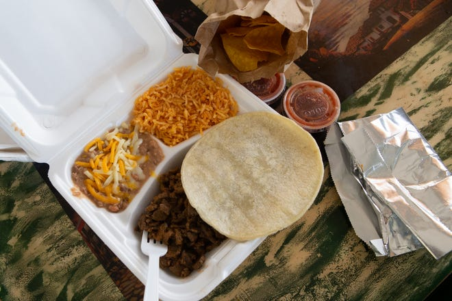 A hearty serving of carne asada meat is accompanied by rice, beans, chips and salsa when ordered as a meal at Tacos El Sol, 2124 S.E. 6th Ave., for $13.63 with tax.