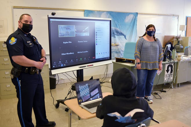 School resource officer Todd Laporte talks with Kelly McCarthy's English class at David Prouty High School Thursday in Spencer.