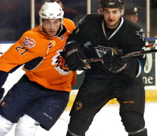 The Sharks' Dan Spang, right, keeps his distance from the Bridgeport Sound Tigers' Jeremy Colliton with an elbow during a game in March 2008 at the DCU Center.