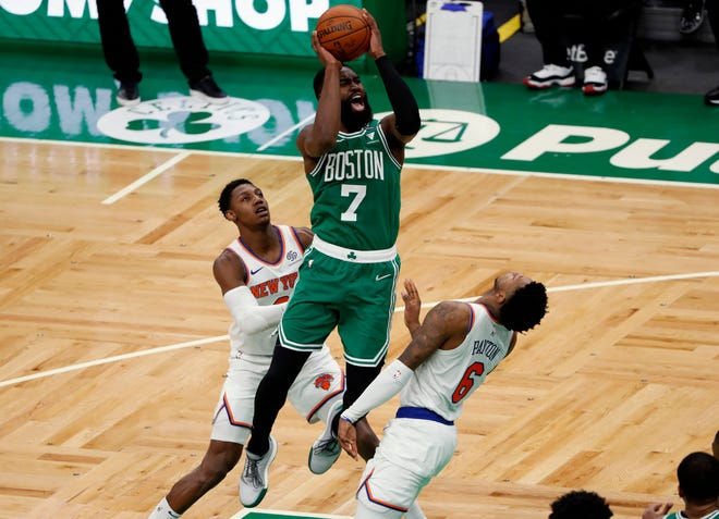 Celtics guard Jaylen Brown shoots over Knicks guard Elfrid Payton (6) as guard RJ Barrett  looks on during the third quarter Wednesday night at TD Garden.