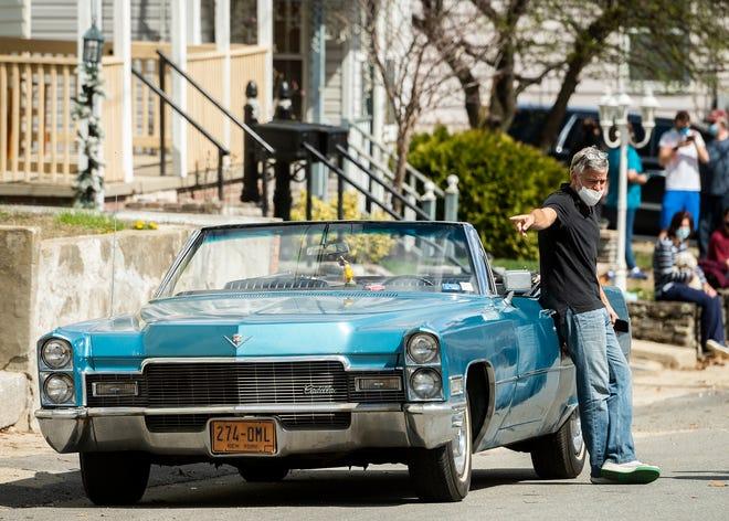 Director George Clooney on set on Maverick Street in Fitchburg April 8.
