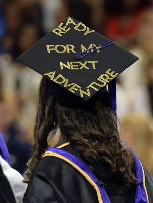 A forward-looking graduate at the 2019 commencement ceremony of the College of the Holy Cross.