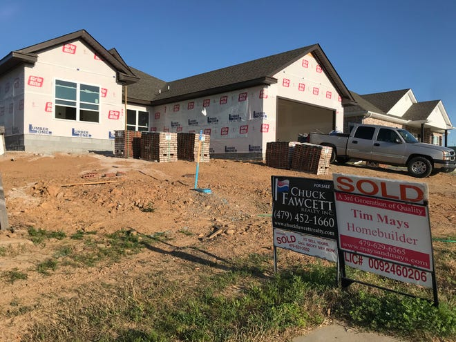"A home under construction in Lakeside Crossing at Chaffee Crossing is posted with a ""sold"" sign. Realtors in Fort Smith say the housing market is low on supply and high on demand, pushing prices above the listing price while construction costs increase for new homes."