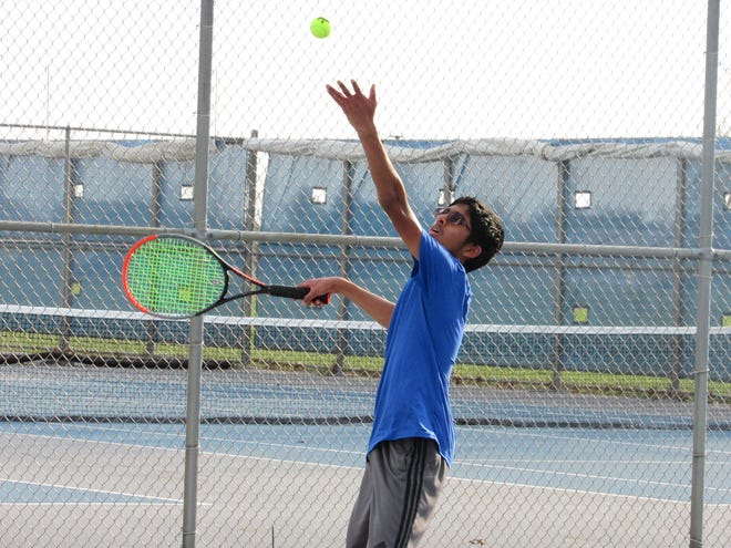 """Liberty freshman Krish Badri competes at third singles April 7 at Pickerington North. First-year coach Adrian Tolentino has been impressed with the Patriots' work ethic, saying players have been """"battling to secure their spots in the lineup."""""""