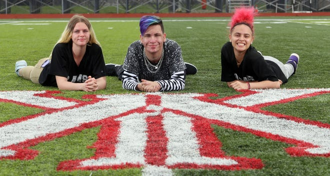 Whitehall-Yearling High School senior Katlynn Johnson (left), senior Jonathan Ward and junior Leah Stuckey are among the students pleased that prom is returning. They are posing on the football field where the May 7 event will be held.
