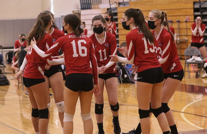 The Natick girls volleyball team celebrated their 24th point, which got them to one point away from winning the first game against Wellesley, April 8, 2021. They came away with the 3-0 win.