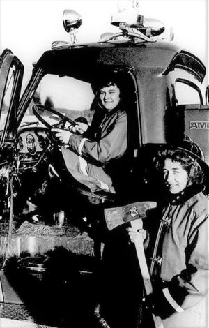 Hazel Gable, in the driver's seat, was the first female volunteer firefighter at the Grove Fire Department after going through the training in 1972. Margaret Furguile, right, quickly followed suit.