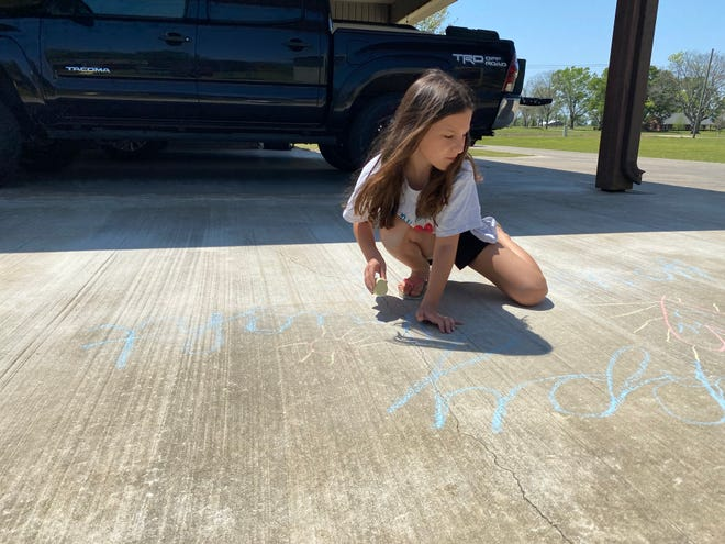 Kennedy Guidry, 8, works on recreating her design that now can be purchased on a T-shirt in a fundraiser for the Children's Advocacy Network, a nonprofit that helps abused and neglected children across Central Louisiana.