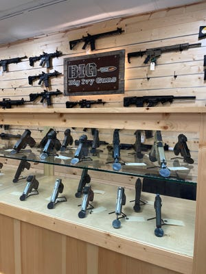 Big Ivy Guns owner Clint Shepherd says it's been hard to keep the store fully stocked over the past year, as the pandemic, social unrest and contentious politics have driven a surge in gun sales.
