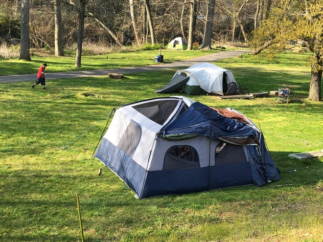 More than a dozen tents have popped up in Riverbend Park near the Walmart in East Asheville. The city of Asheville says it issued campers there notices on April 12 saying they have seven days to leave.