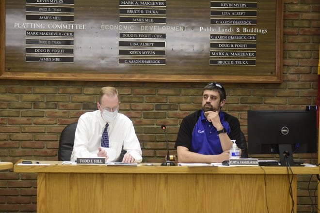 Bucyrus Council Clerk Todd Hill, left, and Council President Kurt Fankhauser sit next to one another during a regular council meeting Tuesday.