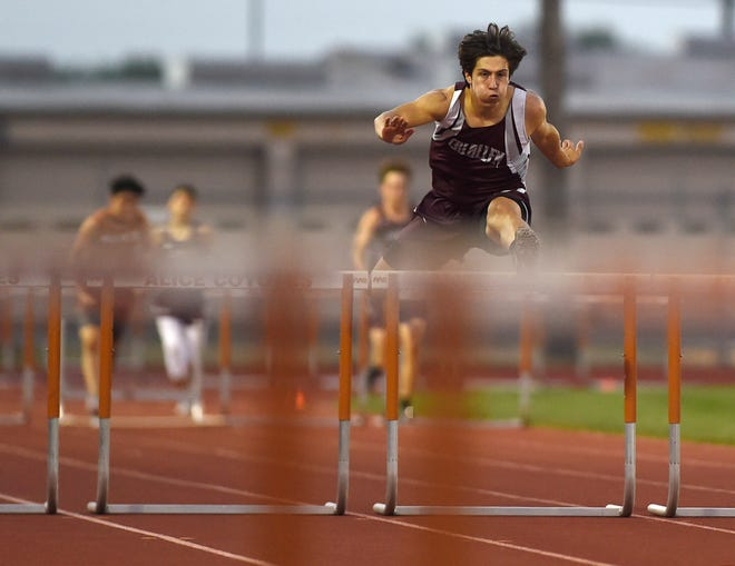 Calallen's Justice McClure competes in the hurdles at the District 31-4A track meet, Wednesday, April 7, 2021, in Alice. Calallen, Alice, Tuloso-Midway, Kingsville and Robstown had athletes compete.
