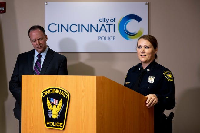 Cincinnati Police Lt. Col. Lisa Davis speaks as Lt. David Johnston stands behind her during a press conference about multiple homicide indictments on Thursday, April 8, 2021, in Cincinnati.
