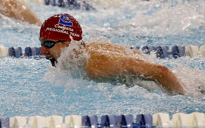 Brandon Thomas, from Conner High School, competes in the Boys 200 Yard Individual Medley during the KHSAA Region Seven Swimming and Diving Championships at SilverLake in Erlanger April 8, 2021.