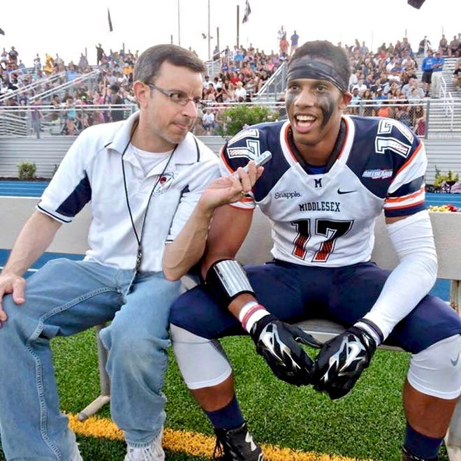 Greg Tufaro interviews wide receiver Javon Hicks of the Middlesex All-Star team during Snapple Bowl XXII at Kean University's Alumni Stadium.