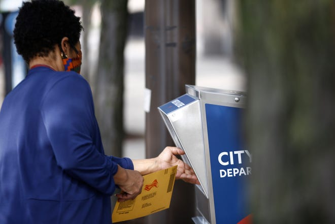 Residents of Detroit drop off their ballots at the primary ballot drop box in the front of the City of Detroit Department of Elections building on Monday, August 3, 2020.