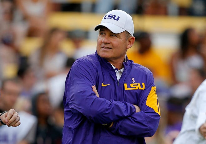 FILE - In a $50 million federal racketeering lawsuit, an associate athletic director at LSU accuses university officials of retaliating against her for reporting racist remarks and inappropriate sexual behavior by former head football coach Les Miles.