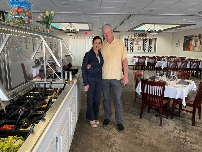 """Steve Van and his fiancee Lilia Amatore pose in the dining room of River's Bend Supper Club in Howard. Van says customers """"love having an Old-Fashioned, the ice cream drinks like a grasshopper, and an actual salad bar."""""""