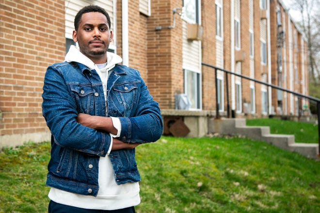 Mohamed Ahmed, 25, was one of the early participants in the UI Labor Center's pre-apprenticeship program. He poses for a photo, Thursday, April 8, 2021, in Iowa City, Iowa.